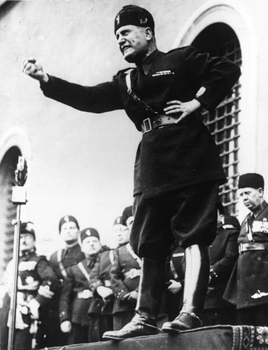 circa 1934: Italian fascist dictator Benito Mussolini (1883 - 1945) shaking his fist during a speech. (Photo by Keystone/Getty Images)